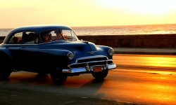 Car driving at sunset, Havana, Cuba