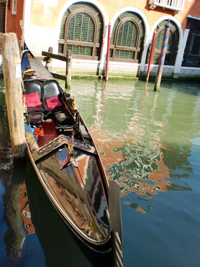 Empty parked Gondola on a canal in Venice, Italy