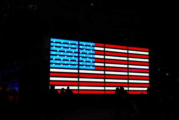 American Flag in Times Square at Night