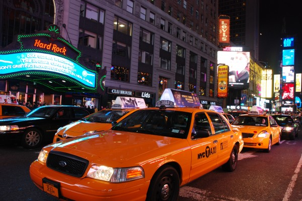 Yellow Taxis in Times Square at Night