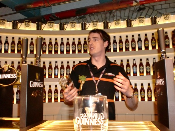 Demonstrating how to pour a pint of Guinness at the Guinness Storehouse, Dublin