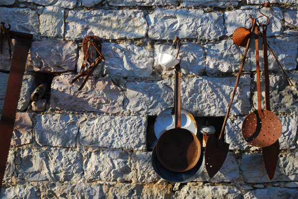 Tools hanging on a wall in Gornja Lastva, Montenegro