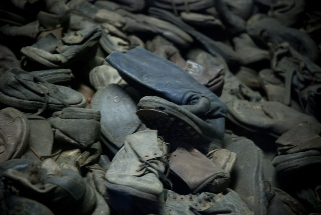 Wellington boot on a pile of children's shoes at Auschwitz