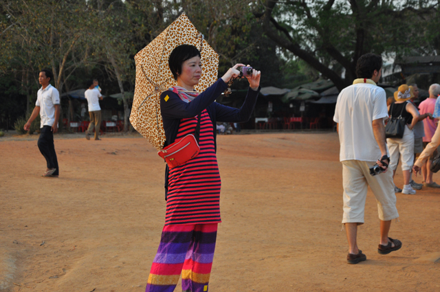Colourful lady tourist at Angkor Wat, Cambodia