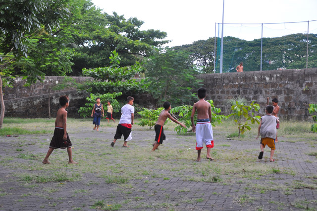 Kids playing sports in Intramuros